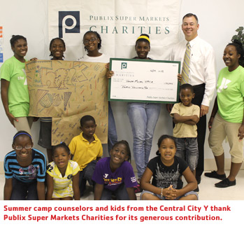 Summer camp counselors and kids from the Central City Y thank Publix Super Markets Charities for its generous contribution.