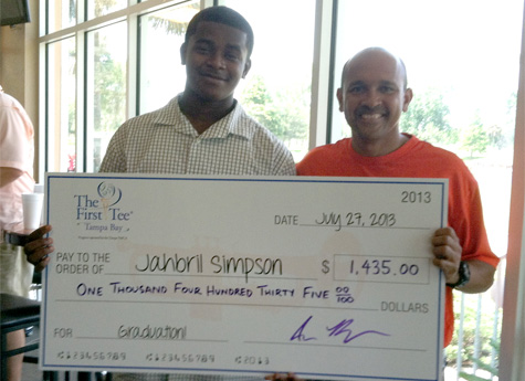 Jahbril Simpson (left) with The First Tee of Tampa Bay Board Member Kennie Sims.